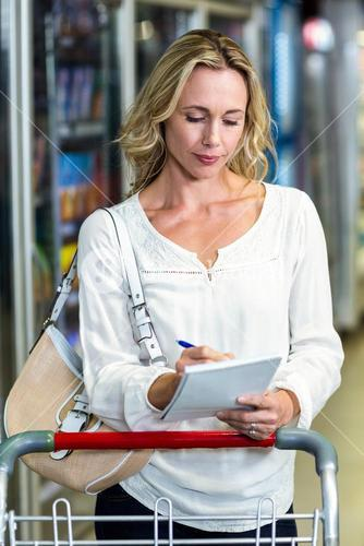 Blonde woman checking list