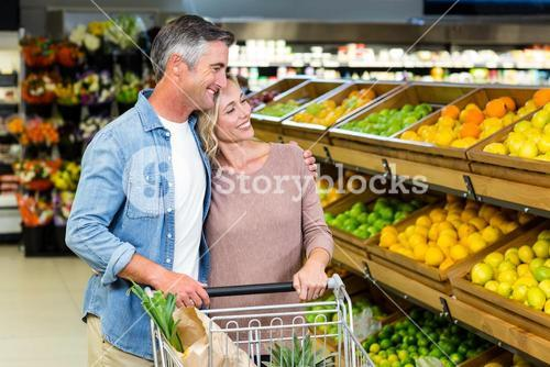 Smiling couple buying food products