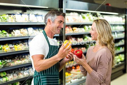 Smiling blonde woman buying a vegetables