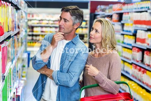 Thoughtful couple choosing a product