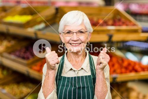 Senior female worker with thumbs up