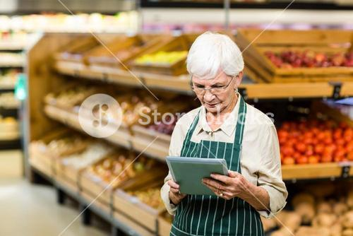 Senior employee working with tablet