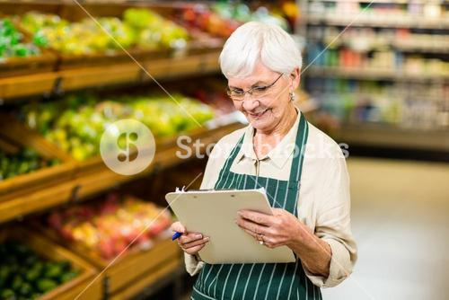 Smiling senior worker with clipboard