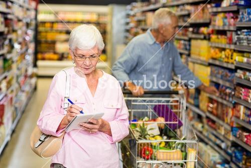 Senior woman with shopping list
