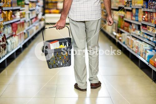 Rear view of senior man holding basket