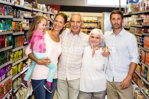 Happy extended family at the supermarket