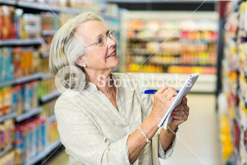 Senior woman checking list