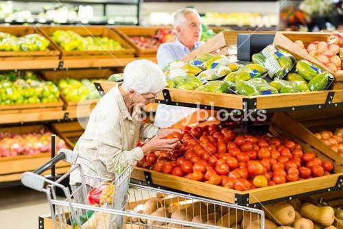 Senior couple buying food at the grocery
