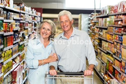 Smiling senior couple with cart