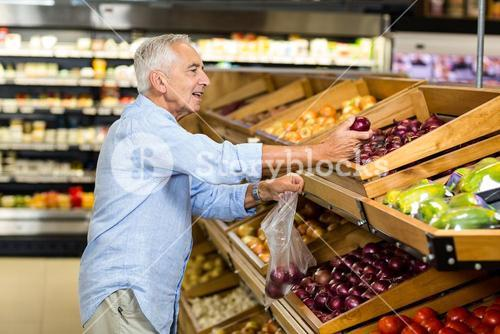 Senior man buying red onion