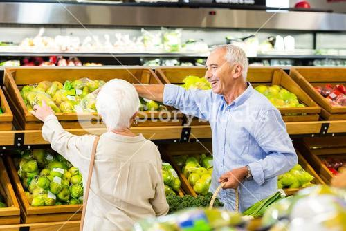 Senior couple picking out fruits together