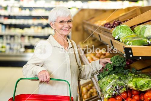 Senior woman picking out some vegetables