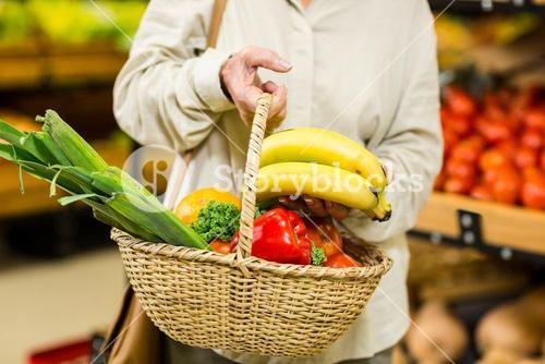 Senior woman holding wicker basket