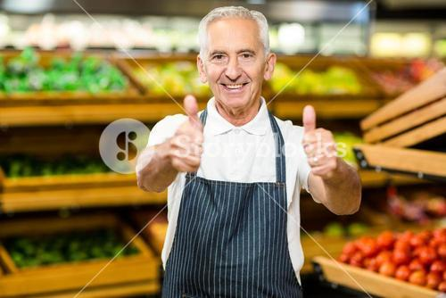 Senior worker showing thumbs ups