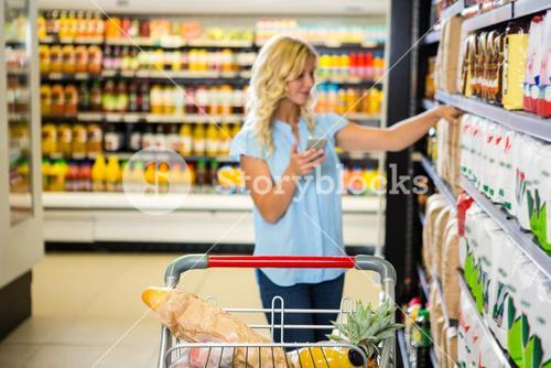 Woman holding smartphone and choosing product