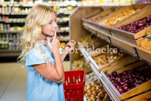 Thoughtful woman looking at onions