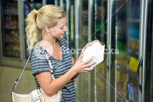 Blonde woman looking at product