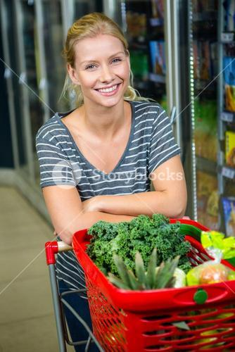 Portrait of smiling woman with shopping basket