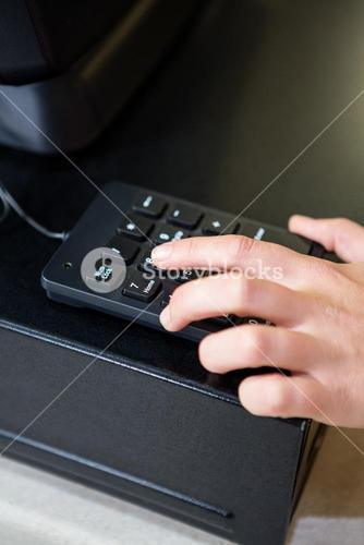 Womans hand holding calculator