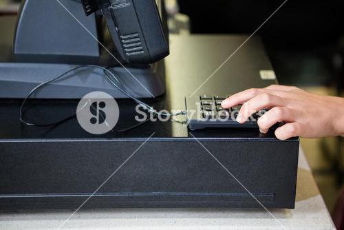 Womans hand using calculator