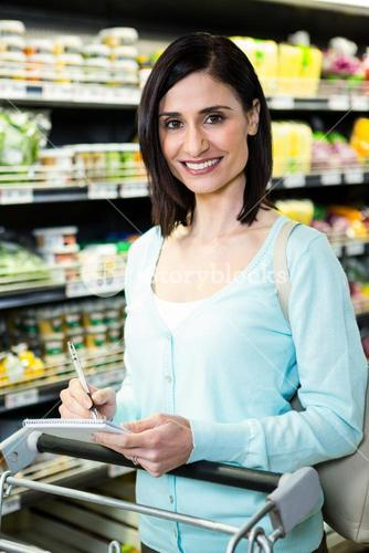 Smiling woman checking list