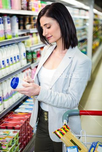 Smiling woman holding dairy product