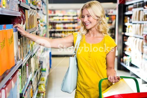Woman with basket picking a product