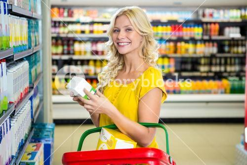 Blonde woman holding product