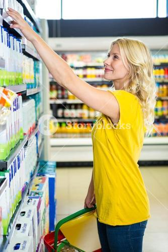 Blonde woman picking product