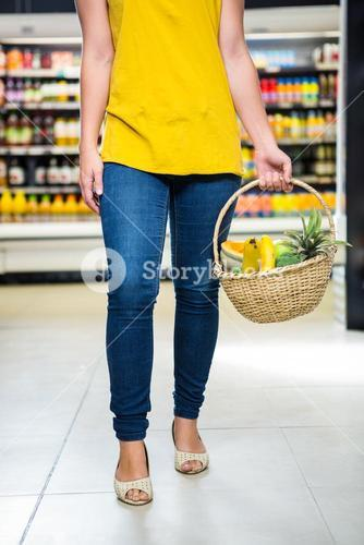 Cropped image of woman holding basket