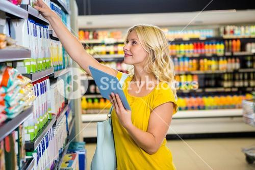 Woman with tablet in aisle