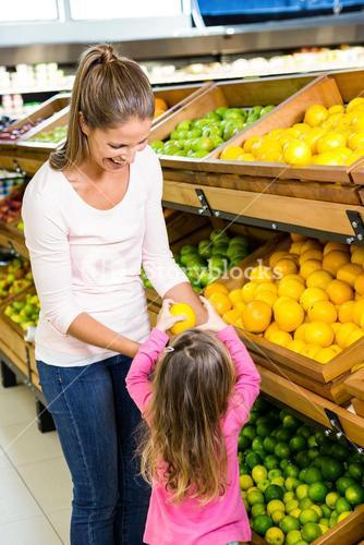 Mother and daughter taking fruit