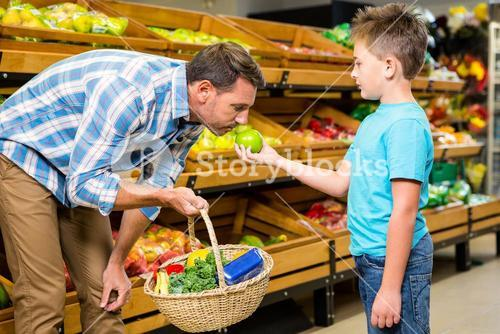 Father and son doing shopping