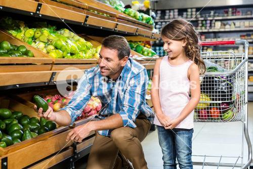Father and daughter doing shopping
