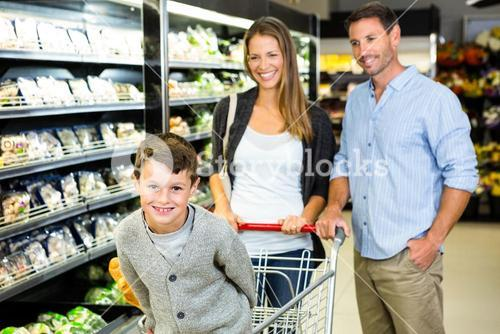 Smiling family doing shopping