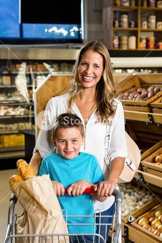Smiling mother and son with cart