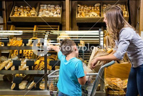 Mother and son looking at bread