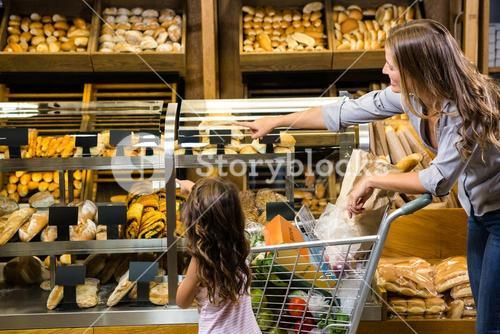 Mother and daughter looking at bread