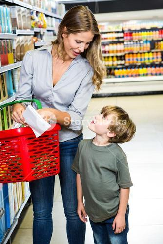Mother and son reading shopping list