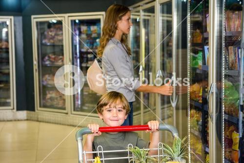 Mother and son doing grocery shopping