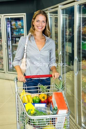 Pretty woman doing her grocery shopping