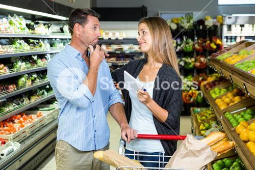 Cute couple doing grocery shopping together