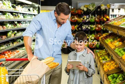 Father and son reading the grocery list
