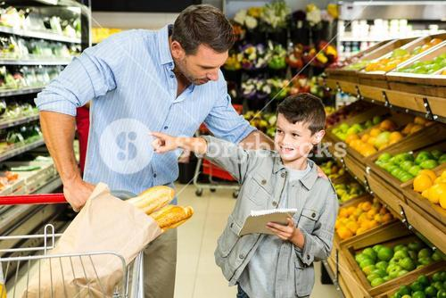 Father and son doing grocery shopping