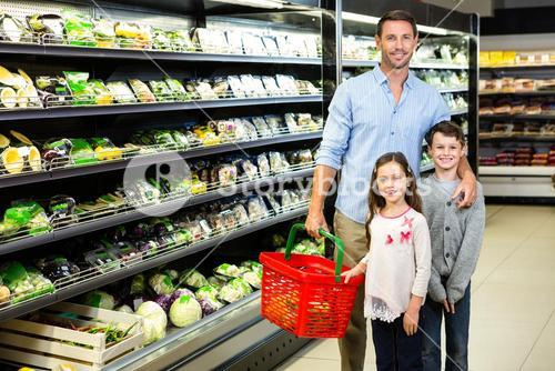 Father and children doing grocery shopping