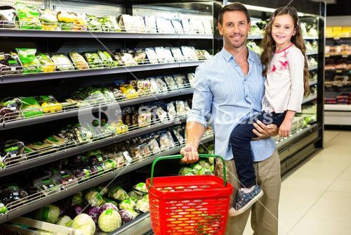 Father and daughter doing grocery shopping