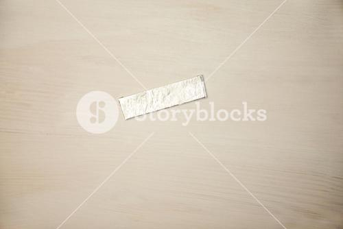 Chewing gum wrapper on wooden desk