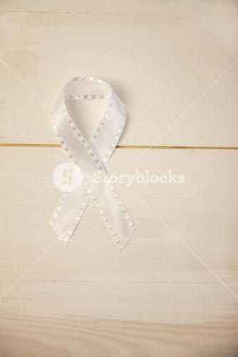 White ribbon on wooden desk