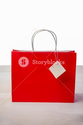 Red shopping gift bag with tag
