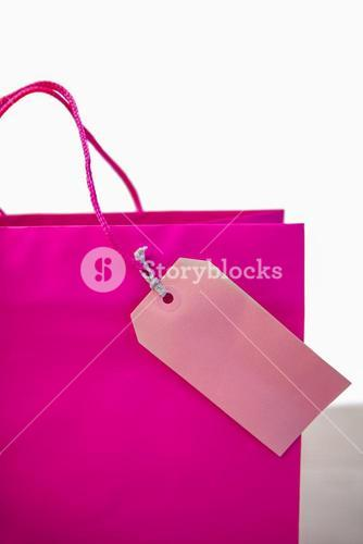 Pink gift bag with tag